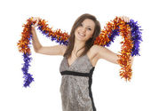 Smiling girl with christmas chain — Stock Photo