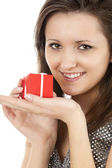 Smiling girl with red gift box — Stock Photo
