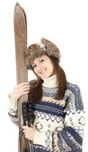 Young woman with old wooden skis — Стоковое фото