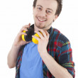 Young man with safety earphones - Stockfoto