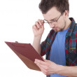 Reading young man with clipboard - Stock Photo