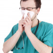 Stock Photo: Male doctor with a runny nose
