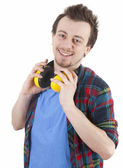 Young man with safety earphones — Stock Photo