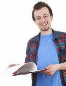 Student mann mit zwischenablage — Stockfoto