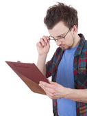 Reading young man with clipboard — Stockfoto
