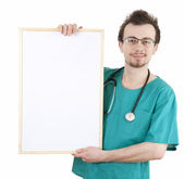 Standing doctor with billboard — Stok fotoğraf