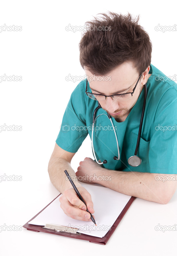 Male doctor writing on clipboard sitting at desk, white background — Stock Photo #9759820