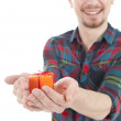 Smiling guy with gift box — Stock Photo