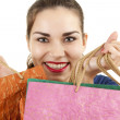 Stock Photo: Smiling shopping young woman