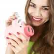Girl with pink piggy bank — Stock Photo