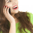 Laughing young woman on the phone — Stockfoto