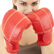 Girl wearing boxing gloves — Stock Photo