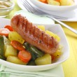 Sausage with vegetables — Stock Photo