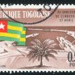Togolese Flag and Lome Harbour - Stok fotoğraf
