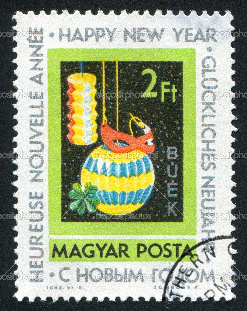 HUNGARY – CIRCA 1963: stamp printed by Hungary, shows lanterns, mask and clover, circa 1963 — Lizenzfreies Foto #9385435