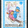 Stock Photo: Children Skiing and Sledging