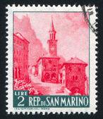 Straße und borgo maggiore kirche — Stockfoto