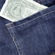 Jeans and dollar - Stock Photo