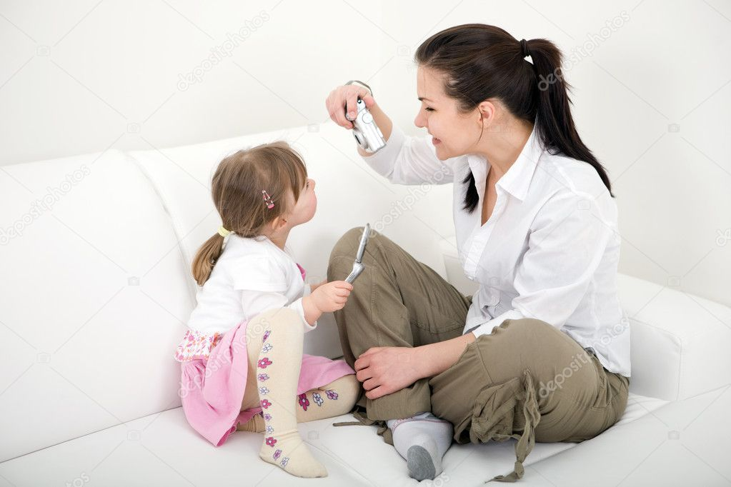Mother and daughter having fun at home — Stock Photo #9648147
