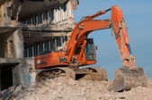 Digger working during the demolition of the building — Stock Photo