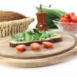Fresh ramson bread and tomatoes - Stock Photo