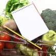 Shopping list with pencil, basket and fresh vegetables — Stock Photo