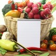 Stock Photo: Purchasing paper with basket and vegetables