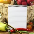 Purchasing paper with fresh vegetables — Stock Photo