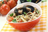 Spaghetti with mussels and parsley — Stock Photo