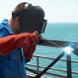 Stock Photo: Welder working with metal construction