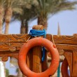 Orange colored life buoy — Stock Photo