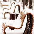 Wooden park bench in a sunny day - winter time — Foto Stock