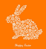 Easter greeting card with bunny and flowered pattern — Stock Vector