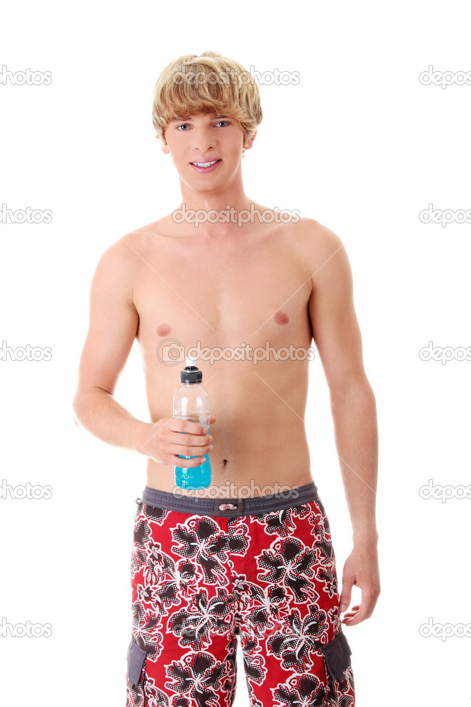 Young athletic man with energy drink after his exercising at gym. Isolated on white background — Stock Photo #10054869