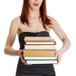 Shocked student girl holding books — Stock Photo