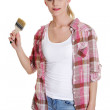 Young woman holding a paintbrush — Stock Photo