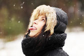 Woman eating snowflakes — Stock Photo