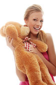 Charming blondeembraces teddy bear — Stock Photo