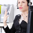 Mad businesswoman talking by headset. — Stock Photo