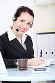 Writng businesswoman in headset. — 图库照片