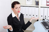 Businesswoman gesturing do not know what to do. — Stock Photo