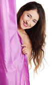 Beautiful woman covering her body with shower curtain — Stock Photo