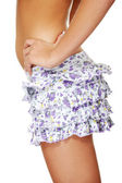 Young sexy woman wearing short skirt — Stock Photo