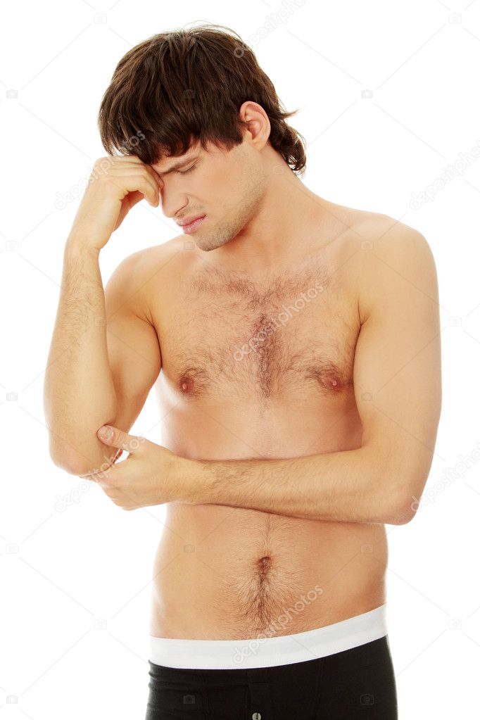 Man having headache. Isolated over white background.  Stock Photo #9200000