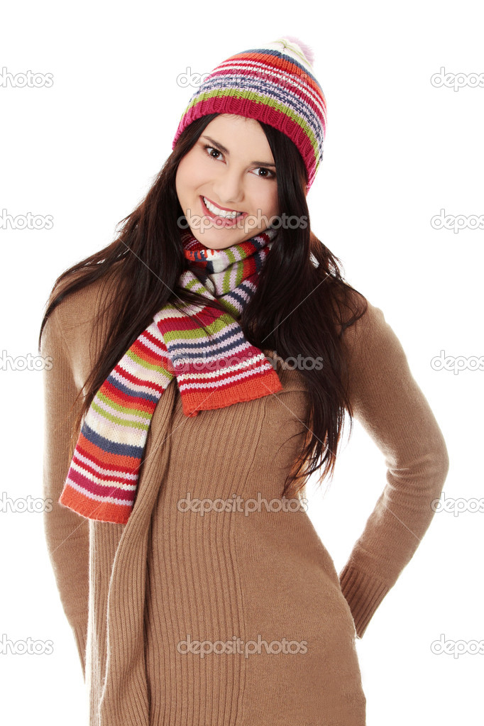 Close up of young woman with winter cap smiling at the camera isoalted on white background  Stock Photo #9200069