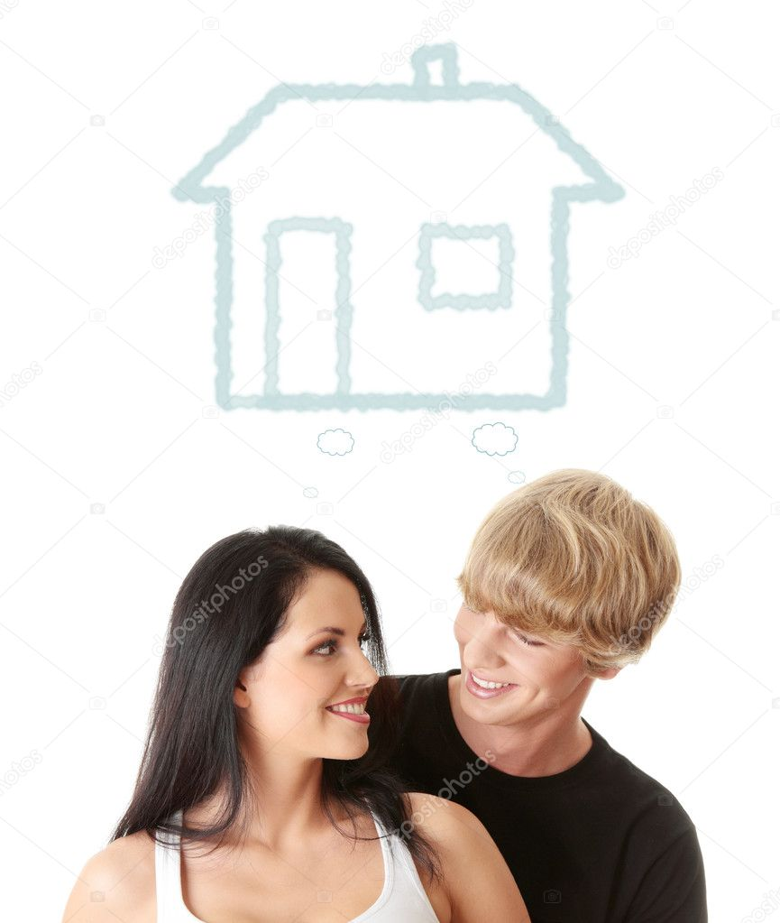 Happy young couple dreaming about their new home. Isolated on white background — Stock Photo #9200339