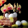 Stock Photo: Easter, eggs and spring yellow orchid with drop of dew