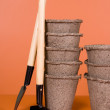 Peat pots and garden tools — Stock Photo