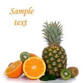 Pineapple, oranges and kiwi — Stock Photo