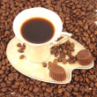 Cup of coffee with beans — Stock Photo #8397970